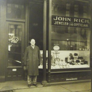 John B. Rich Jr. in front the store